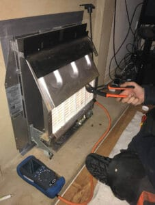 Landlord gas safety check on a gas fire