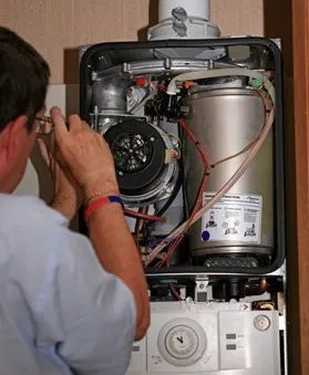 Repairing a boiler, ATB plumbing and Heating